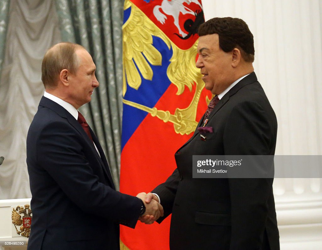 Russian President <a gi-track='captionPersonalityLinkClicked' href=/galleries/search?phrase=Vladimir+Putin&family=editorial&specificpeople=154896 ng-click='$event.stopPropagation()'>Vladimir Putin</a> meets with Soviet songs pop singer, State Duma Deputy Joseph Kobzon (R)speaks during the awarding ceremony at the Kremlin April, 30, 2016 in Moscow, Russia. Putin presented Hero of Labour medals to five winners. The awards were given to Russians who made a considerable contribution to the country's social and economic development, including development of culture, education, industry and agriculture.