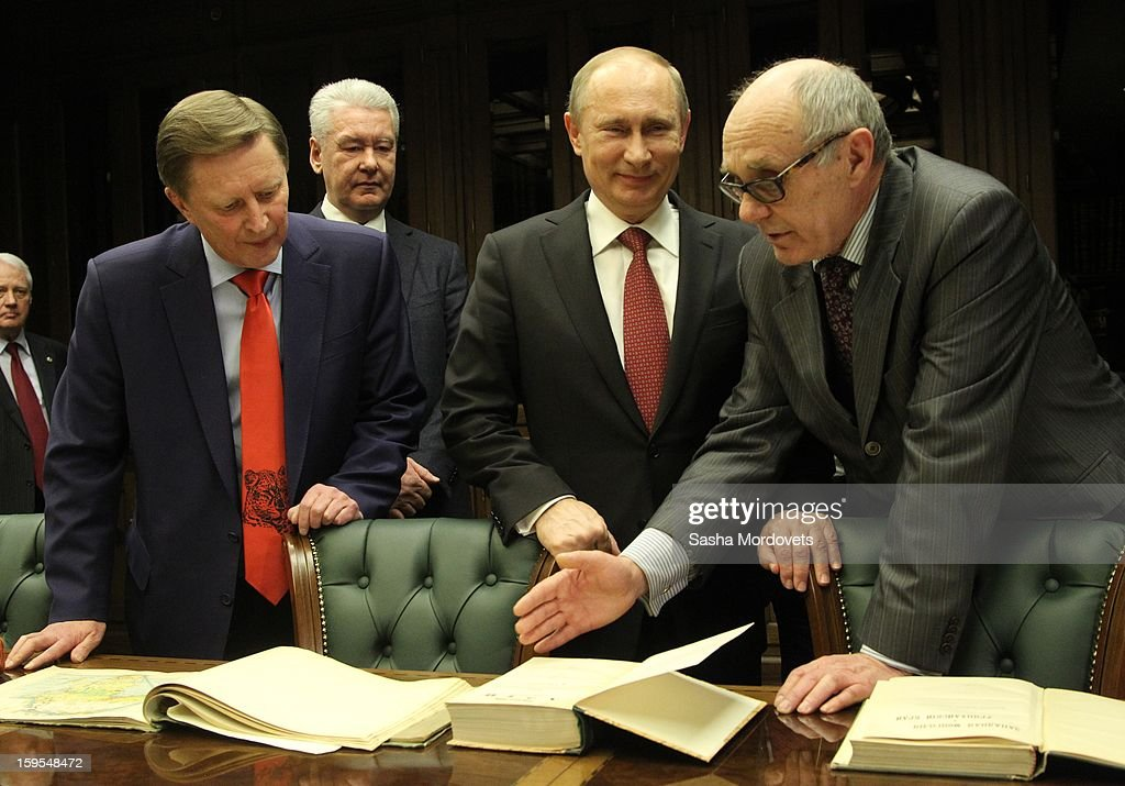 Russian President <a gi-track='captionPersonalityLinkClicked' href=/galleries/search?phrase=Vladimir+Putin&family=editorial&specificpeople=154896 ng-click='$event.stopPropagation()'>Vladimir Putin</a> (C), Moscow Mayor Sergey Sobyanin (2L) and Chief of the Presidential Administration Sergey Ivanov (L) attend the openings of the Russia Geographical Society new headquarters on January 15, 2013 in Moscow, Russia.