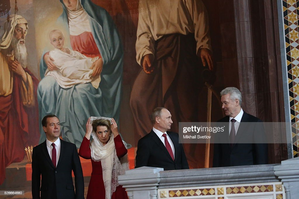 Russian President Vladimir Putin (2R), Moscow's Mayor Sergei Sobyanin (R), Prime Minister Dmitry Medvedev (L) and his wife Svetlana Medvedeva (2L) attends the Orthodox Easter mass at the Christ The Saviour Catherdal, in Moscow, Russia, May,1, 2016. Russian President Vladimir Putin, Moscow Mayor Sergei Sobyanin, Prime Minister Dmitry Medvedev and his wife Svetlana took part an Orthodox Easter service held by Patriarch Kirill at the biggest Russian Orthodox Cathedral.