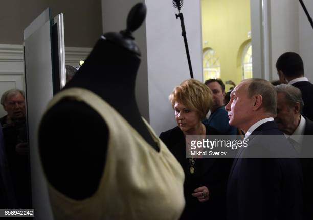Russian President Vladimir Putin observes an exhibition as he visits the Maly Theatre to watch the comedy 'The Last Victim' by Russian writer...