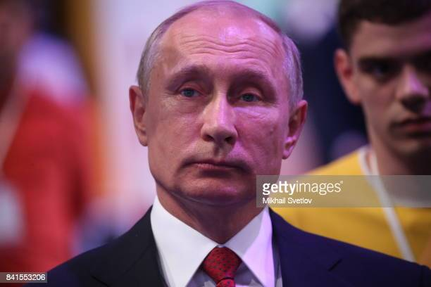Russian President Vladimir Putin observes an exhibition prior to the AllRussia's Open Lesson in Yaroslavlon September 1 2017 260 km north of Moscow...