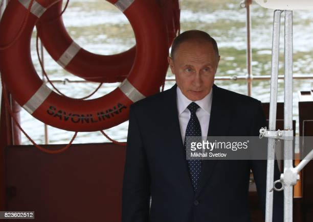 Russian President Vladimir Putin on a boat during his meeting with Finland's President Sauli Niinisto July 27 2017 in Savonlinna Finland Putin is...