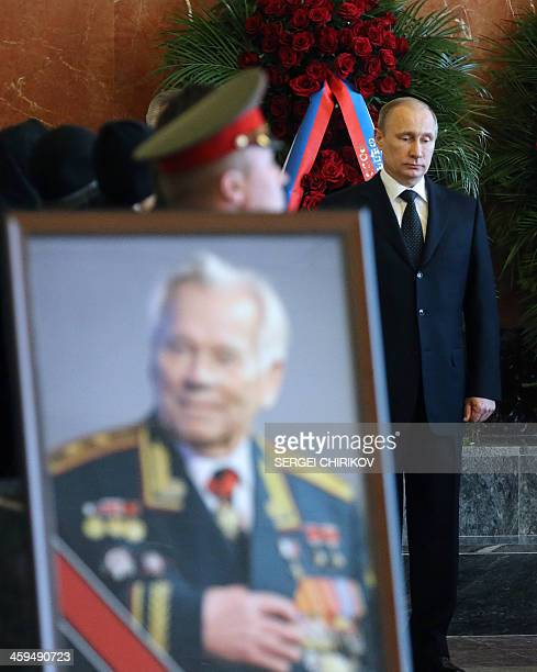 Russian President Vladimir Putin pays his last respects to late Mikhail Kalashnikov the designer of the iconic AK47 assault rifle that was the...