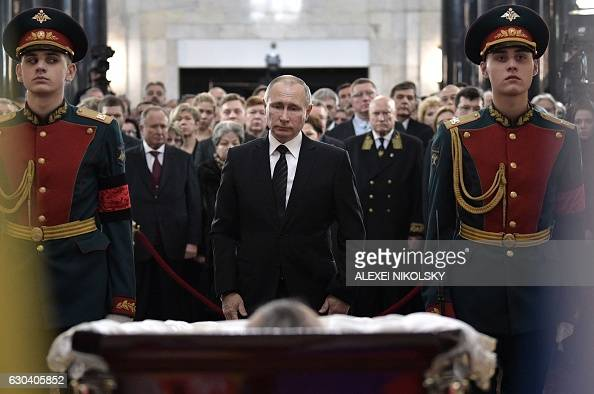 TOPSHOT Russian President Vladimir Putin pays his respects to slain Russian Ambassador to Turkey Andrei Karlov during the funeral ceremony at the...
