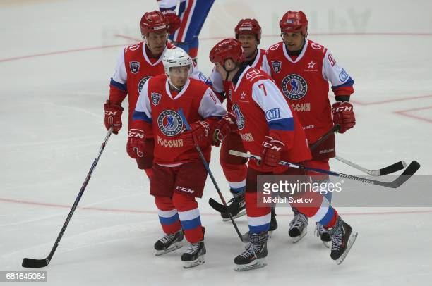 Russian President Vladimir Putin plays ice hockey with retired NHL players Slava Fetisov Pavel Bure and Alexey Kasatonov during the gala match of the...