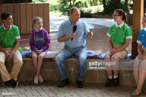 Russian President Vladimir Putin points during his meeting at Artek camp an international children center on the Black Sea on June 24 2017 in Hurzuf...