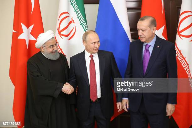 Russian President Vladimir Putin pose for a photo with Turkish President Recep Tayyip Erdogan and Iranian President Hassan Rouhani prior to their...
