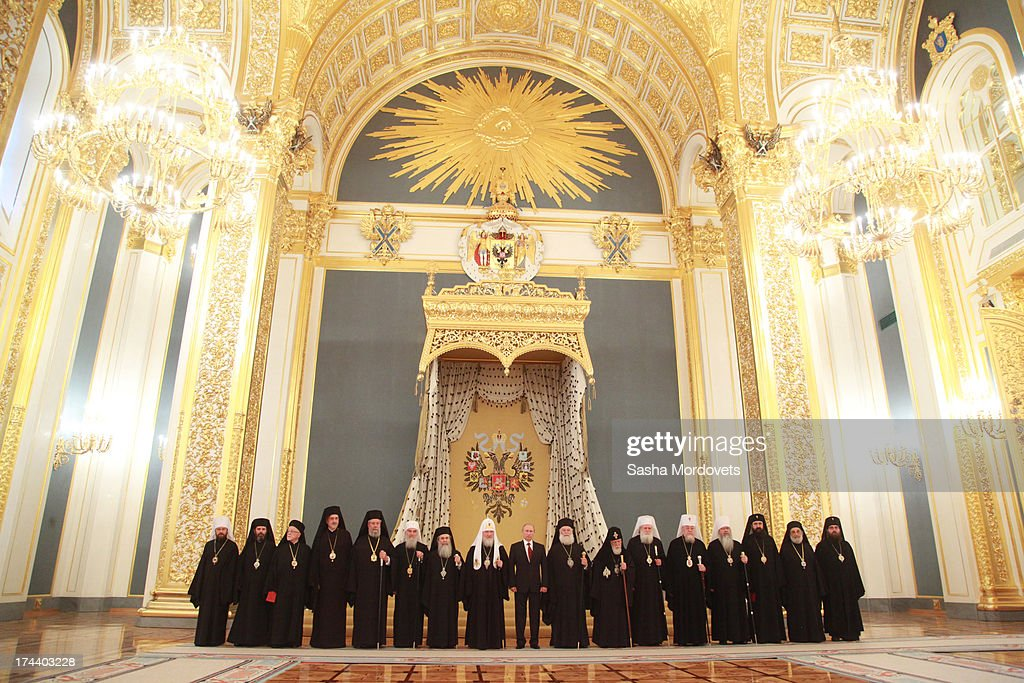 Russian President Vladimir Putin (C) poses for a photo during a meeting with Orthodox Churches leaders in the Kremlin on July 25, 2013 in Moscow, Russia. Orthodox Patriarchs have traveled to Moscow to celebrate the 1025th anniversary of Christianity in Russia.