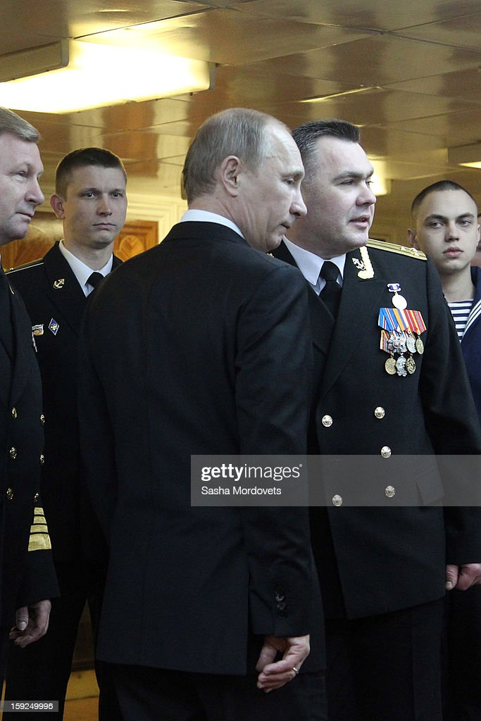 Russian President <a gi-track='captionPersonalityLinkClicked' href=/galleries/search?phrase=Vladimir+Putin&family=editorial&specificpeople=154896 ng-click='$event.stopPropagation()'>Vladimir Putin</a> (C) poses for a photo with officers during his visit to the heavy nuclear-powered missile cruiser Pyotr Veliky at the Russian Northern Fleet's base January 10, 2013 in Severomorsk, Russia. Putin awarded the crew of the Pyotr Veliky the Nakhimov order.