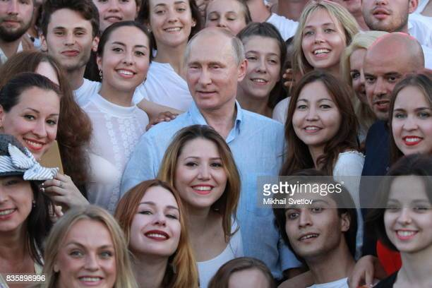 Russian President Vladimir Putin poses for a photo with participants of the Tavrida International Youth Forum August 20 2017 in Steregushcheye at...