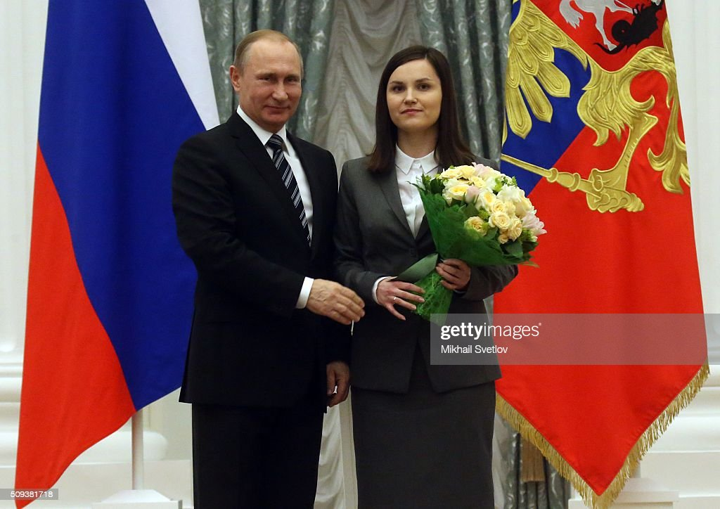 Russian President <a gi-track='captionPersonalityLinkClicked' href=/galleries/search?phrase=Vladimir+Putin&family=editorial&specificpeople=154896 ng-click='$event.stopPropagation()'>Vladimir Putin</a> (L) poses for a photo with Yekaterina Proshkina, PhD in Biology, researcher at the Institute of Biology of the Komi Science Centre of the Russian Academy of Sciences' Ural Branch, during the ceremony to award prizes to young scientists for their contribution to Russian science and innovative activities in 2015, on February 10, 2016 in Moscow, Russia. Russian President Putin awarded 3 scientists during the reception at the Krelmlin.