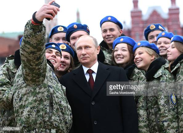 Russian President Vladimir Putin poses for a selfie with cadets during a street rally for National Unity Day in Red Square on November 4 2015 in...