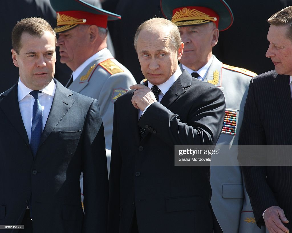 Russian President Vladimir Putin (C), Prime Minister Dmitry Medvedev (L) and Presidential Administation Chief Sergey Ivanov (R) attend a wreath laying ceremony at the Tomb of the Unknown Soldier near the Kremlin on May, 8 2013 in Moscow, Russia. Russia will hold victory parades tomorrow to mark the 68th anniversary of the defeat of Nazi Germany in World War II.