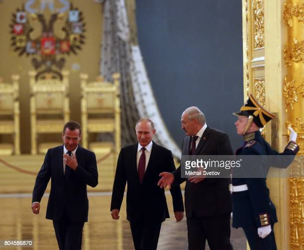 Russian President Vladimir Putin Prime Minister Dmitry Medvedev and President of Belarus Alexander Lukashenko arrive to the Supreme State Council of...