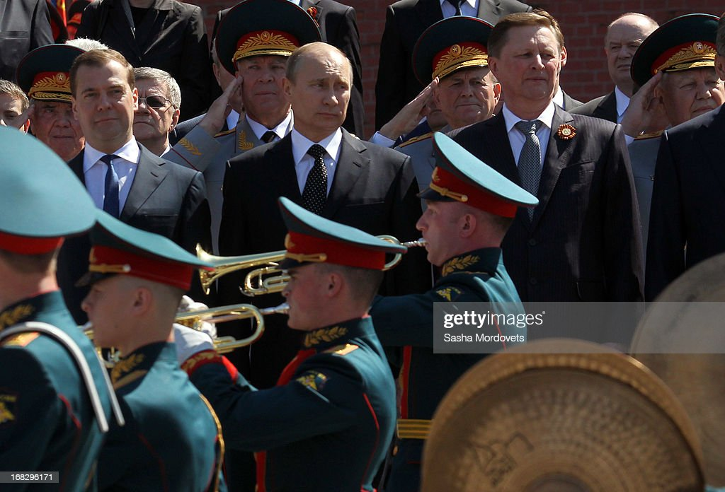 Russian President Vladimir Putin (C), Prime Minister Dmitry Medvedev (2L), Presidential Administration Chief Sergey Ivanov (2R) attend a wreath laying ceremony at the Tomb of the Unknown Soldier near the Kremlin on May, 8 2013 in Moscow, Russia. Russia will hold victory parades tomorrow to mark the 68th anniversary of the defeat of Nazi Germany in World War II.