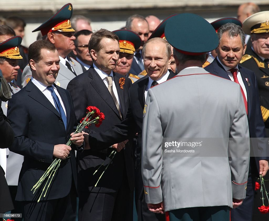 Russian President Vladimir Putin (C), Prime Minister Dmitry Medvedev (L), Defence Minster Sergey Shoigu (R) and State Duma Speaker Sergey Naryshkin (2L) attend a wreath laying ceremony at the Tomb of the Unknown Soldier near the Kremlin on May, 8 2013 in Moscow, Russia. Russia will hold victory parades tomorrow to mark the 68th anniversary of the defeat of Nazi Germany in World War II.