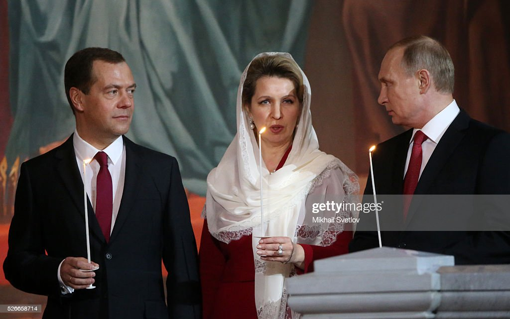 Russian President Vladimir Putin (R), Primier Dmitry Medvedev (C) and his spouse Svetlana Medvedeva (C) attend an Orthodox Easter mass at the Christ The Saviour Catherdal, in Moscow, Russia, May,1, 2016. Russian President Vladimir Putin, Moscow Mayor Sergei Sobyanin, Prime Minister Dmitry Medvedev and his wife Svetlana took part an Orthodox Easter service held by Patriarch Kirill at the biggest Russian Orthodox Cathedral.