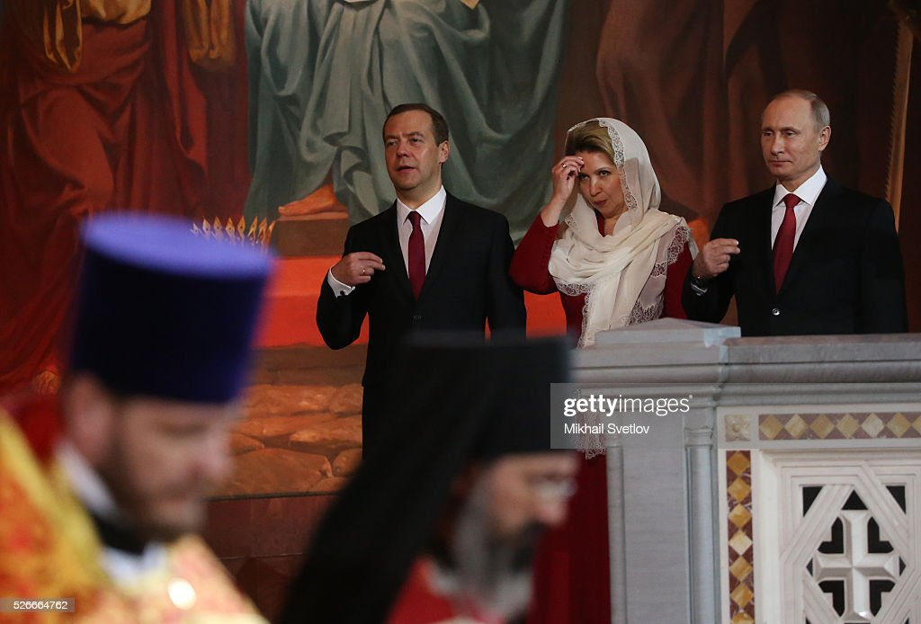Russian President Vladimir Putin (R), Primier Dmitry Medvedev (C) and his spouse Svetlana Medvedeva (2R) attend an Orthodox Easter mass at the Christ The Saviour Catherdal, in Moscow, Russia, May,1, 2016. Russian President Vladimir Putin, Moscow Mayor Sergei Sobyanin, Prime Minister Dmitry Medvedev and his wife Svetlana took part an Orthodox Easter service held by Patriarch Kirill at the biggest Russian Orthodox Cathedral.