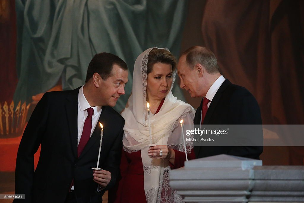 Russian President <a gi-track='captionPersonalityLinkClicked' href=/galleries/search?phrase=Vladimir+Putin&family=editorial&specificpeople=154896 ng-click='$event.stopPropagation()'>Vladimir Putin</a> (R), Primier Dmitry Medvedev (L) and his spouse Svetlana Medvedeva (C) attend an Orthodox Easter mass at the Christ The Saviour Catherdal, in Moscow, Russia, May,1, 2016. Russian President <a gi-track='captionPersonalityLinkClicked' href=/galleries/search?phrase=Vladimir+Putin&family=editorial&specificpeople=154896 ng-click='$event.stopPropagation()'>Vladimir Putin</a>, Moscow Mayor Sergei Sobyanin, Prime Minister Dmitry Medvedev and his wife Svetlana took part an Orthodox Easter service held by Patriarch Kirill at the biggest Russian Orthodox Cathedral.