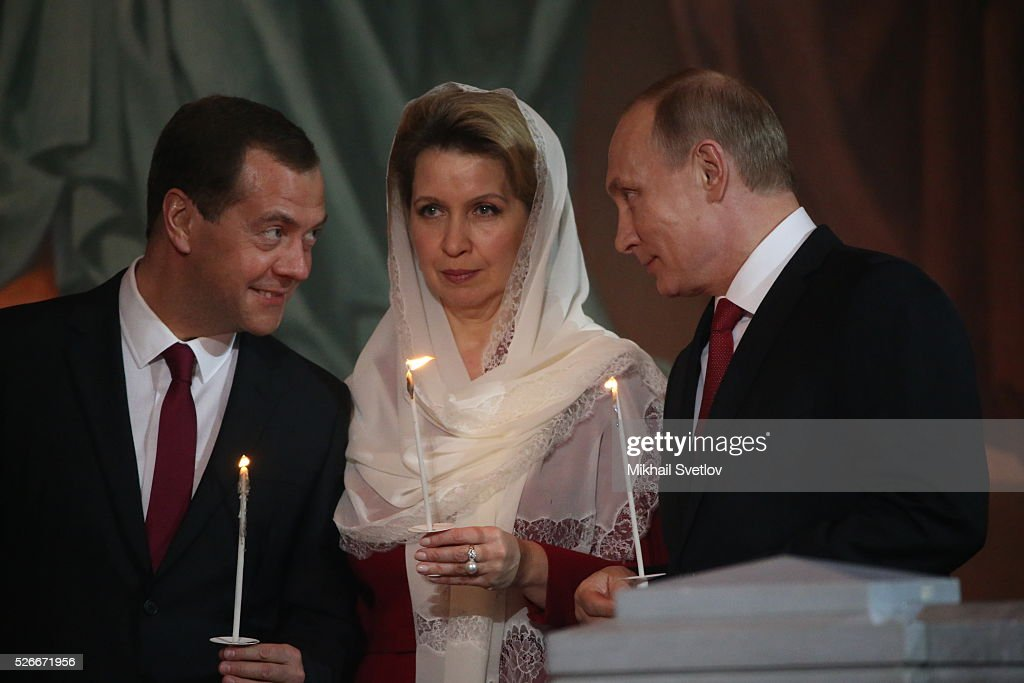 Russian President Vladimir Putin (R), Primier <a gi-track='captionPersonalityLinkClicked' href=/galleries/search?phrase=Dmitry+Medvedev&family=editorial&specificpeople=554704 ng-click='$event.stopPropagation()'>Dmitry Medvedev</a> (L) and his spouse Svetlana Medvedeva (C) attend an Orthodox Easter mass at the Christ The Saviour Catherdal, in Moscow, Russia, May,1, 2016. Russian President Vladimir Putin, Moscow Mayor Sergei Sobyanin, Prime Minister <a gi-track='captionPersonalityLinkClicked' href=/galleries/search?phrase=Dmitry+Medvedev&family=editorial&specificpeople=554704 ng-click='$event.stopPropagation()'>Dmitry Medvedev</a> and his wife Svetlana took part an Orthodox Easter service held by Patriarch Kirill at the biggest Russian Orthodox Cathedral.