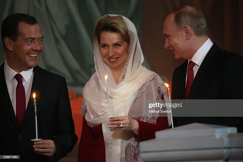 Russian President <a gi-track='captionPersonalityLinkClicked' href=/galleries/search?phrase=Vladimir+Putin&family=editorial&specificpeople=154896 ng-click='$event.stopPropagation()'>Vladimir Putin</a> (R), Primier <a gi-track='captionPersonalityLinkClicked' href=/galleries/search?phrase=Dmitry+Medvedev&family=editorial&specificpeople=554704 ng-click='$event.stopPropagation()'>Dmitry Medvedev</a> (L) and his spouse Svetlana Medvedeva (C) attend an Orthodox Easter mass at the Christ The Saviour Catherdal, in Moscow, Russia, May,1, 2016. Russian President <a gi-track='captionPersonalityLinkClicked' href=/galleries/search?phrase=Vladimir+Putin&family=editorial&specificpeople=154896 ng-click='$event.stopPropagation()'>Vladimir Putin</a>, Moscow Mayor Sergei Sobyanin, Prime Minister <a gi-track='captionPersonalityLinkClicked' href=/galleries/search?phrase=Dmitry+Medvedev&family=editorial&specificpeople=554704 ng-click='$event.stopPropagation()'>Dmitry Medvedev</a> and his wife Svetlana took part an Orthodox Easter service held by Patriarch Kirill at the biggest Russian Orthodox Cathedral.