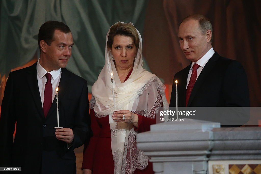 Russian President Vladimir Putin (R), Primier Dmitry Medvedev (L) and his spouse Svetlana Medvedeva (C) attend an Orthodox Easter mass at the Christ The Saviour Catherdal, in Moscow, Russia, May,1, 2016. Russian President Vladimir Putin, Moscow Mayor Sergei Sobyanin, Prime Minister Dmitry Medvedev and his wife Svetlana took part an Orthodox Easter service held by Patriarch Kirill at the biggest Russian Orthodox Cathedral.