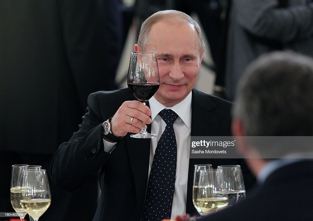 Russian President Vladimir Putin raises a wine glass as he toasts and meets with veterans of the Battle of Stalingrad in the Grand Kremlin Palace February,1,2013 in Moscow, Russia. The meeting comes ahead of Putin's visit to Stalingrad tomorrow for a military parade commemorating the battle that proved pivotal in World War II.