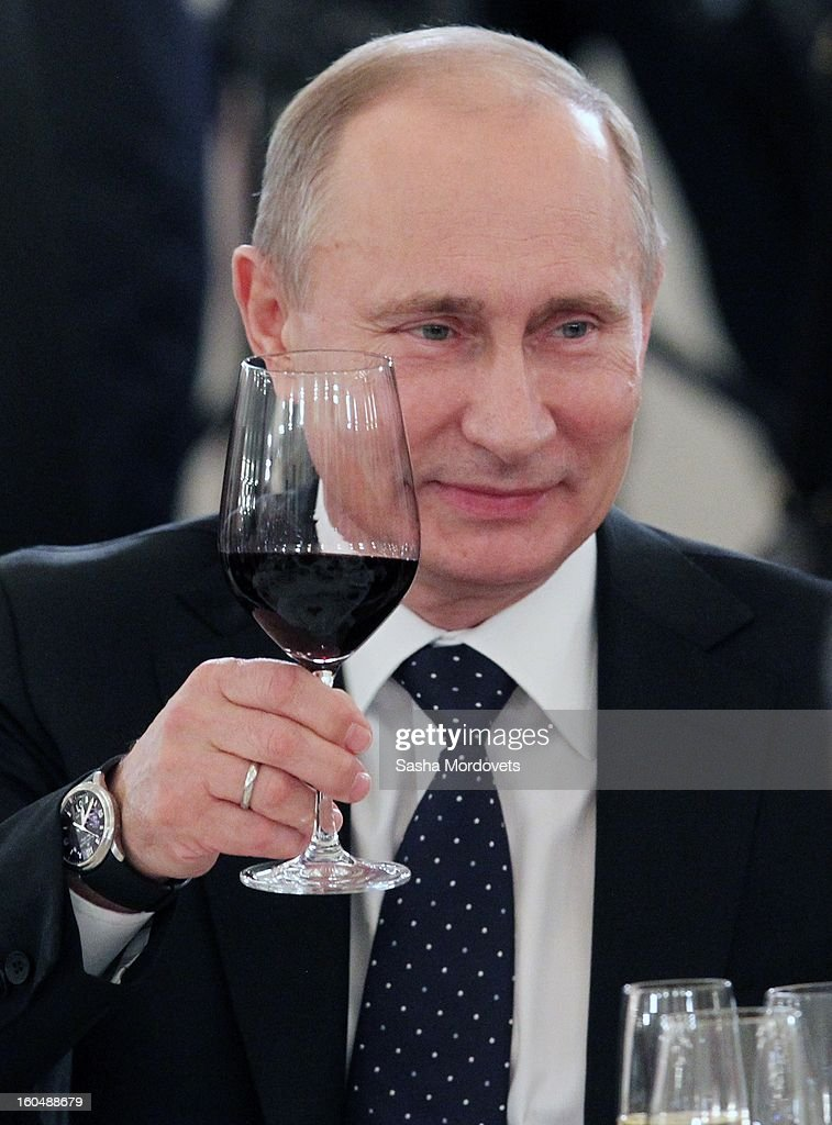 Russian President <a gi-track='captionPersonalityLinkClicked' href=/galleries/search?phrase=Vladimir+Putin&family=editorial&specificpeople=154896 ng-click='$event.stopPropagation()'>Vladimir Putin</a> raises a wine glass as he toasts and meets with veterans of the Battle of Stalingrad in the Grand Kremlin Palace February,1,2013 in Moscow, Russia. The meeting comes ahead of Putin's visit to Stalingrad tomorrow for a military parade commemorating the battle that proved pivotal in World War II.
