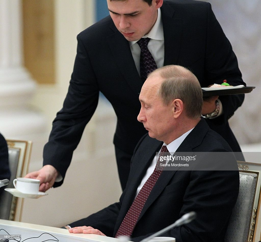 Russian President <a gi-track='captionPersonalityLinkClicked' href=/galleries/search?phrase=Vladimir+Putin&family=editorial&specificpeople=154896 ng-click='$event.stopPropagation()'>Vladimir Putin</a> (R) receives a during a meeting with G20 finance leaders in the Kremlin February 15, 2013 in Moscow, Russia. The G20 countries, that make up 90 percent of the worlds gross domestic product, is reportedly set to be dominated by the issue of counties using their currency fro economic gain over the weekend of meetings.