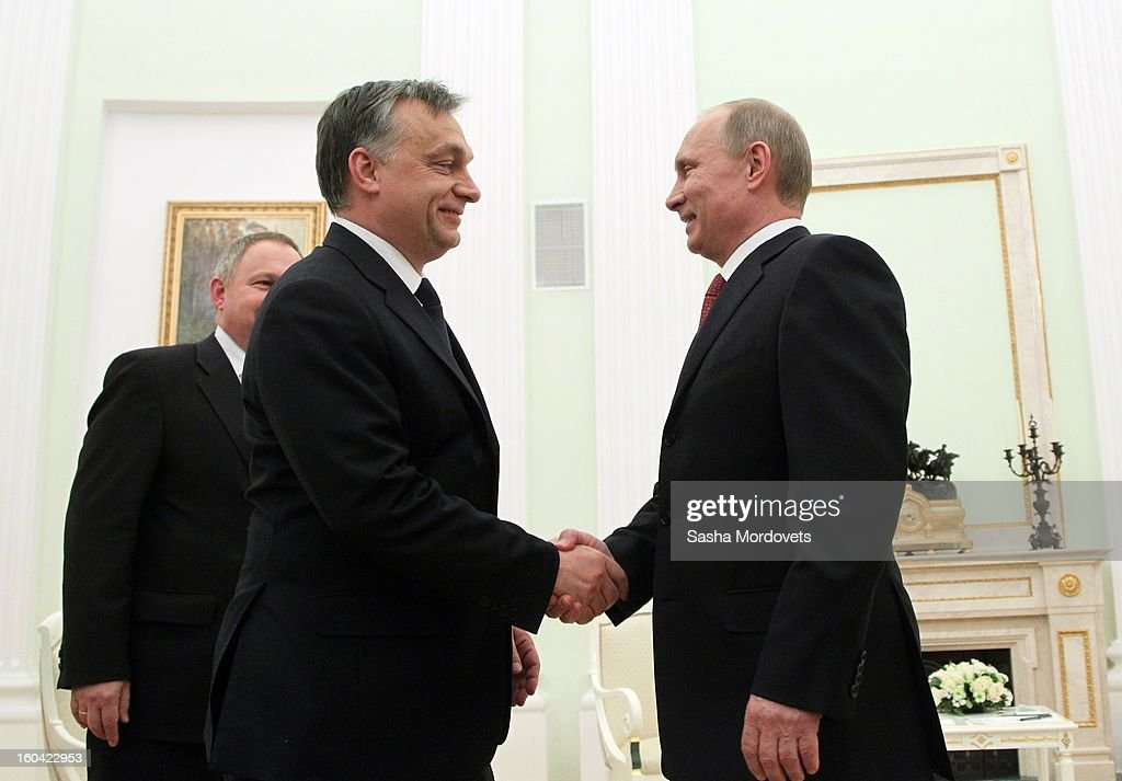 Russian President Vladimir Putin (R) receives Hungarian Prime Minister <a gi-track='captionPersonalityLinkClicked' href=/galleries/search?phrase=Viktor+Orban&family=editorial&specificpeople=4685765 ng-click='$event.stopPropagation()'>Viktor Orban</a> (C) in the Kremlin on January 31, 2013 in Moscow, Russia. Orban is on a one-day visit to Russia.