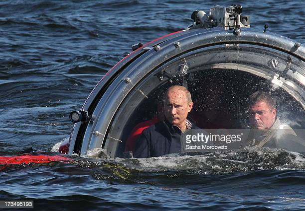 Russian President Vladimir Putin rides in a submersible July 15 2013 in the Baltic Sea near Gotland Island Russia The vessel dove to the sea floor to...