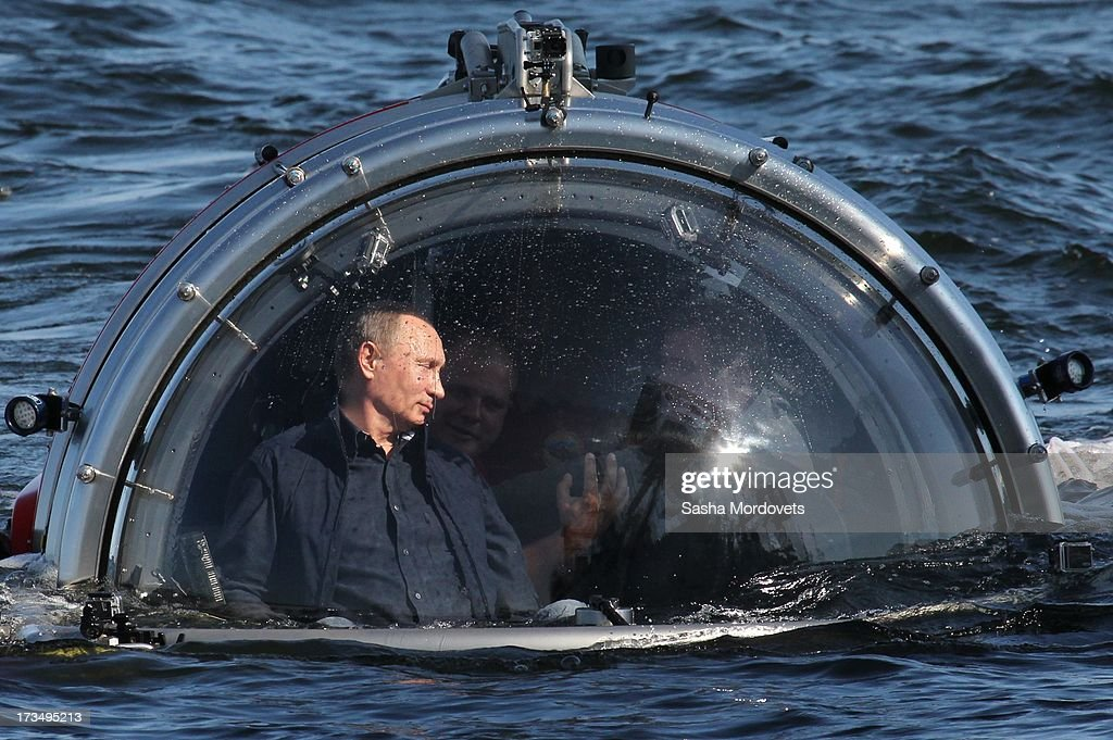Russian President Vladimir Putin rides in a submersible July 15, 2013 in the Baltic Sea near Gotland Island, Russia. The vessel dove to the sea floor to explore a sunken ship in the Gulf of Finland.