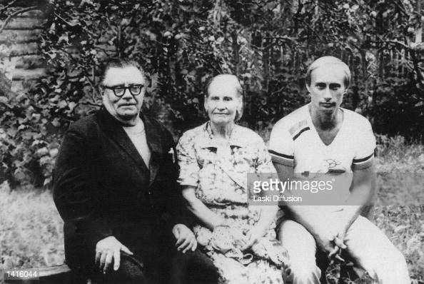 FILE PHOTO Russian President Vladimir Putin right poses for a photograph in this file photo with his parents Maria and Vladimir Putin in1985 just...