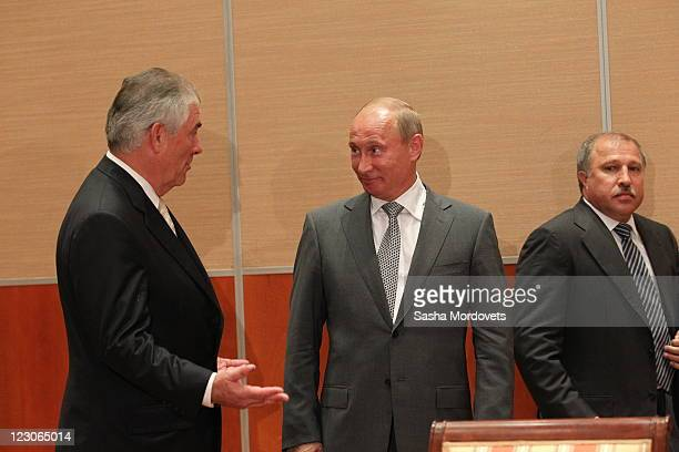 Russian President Vladimir Putin Rosneft President Eduard Hudainatov and Rex Tillerson Chairman and CEO of Exxon Mobil during a signing ceremony for...