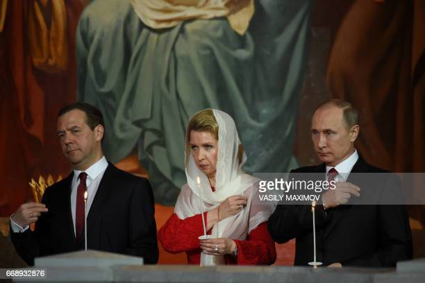 Russian President Vladimir Putin Russian Prime Minister Dmitry Medvedev and his wife Svetlana attend Orthodox Easter celebrations at the Christ the...