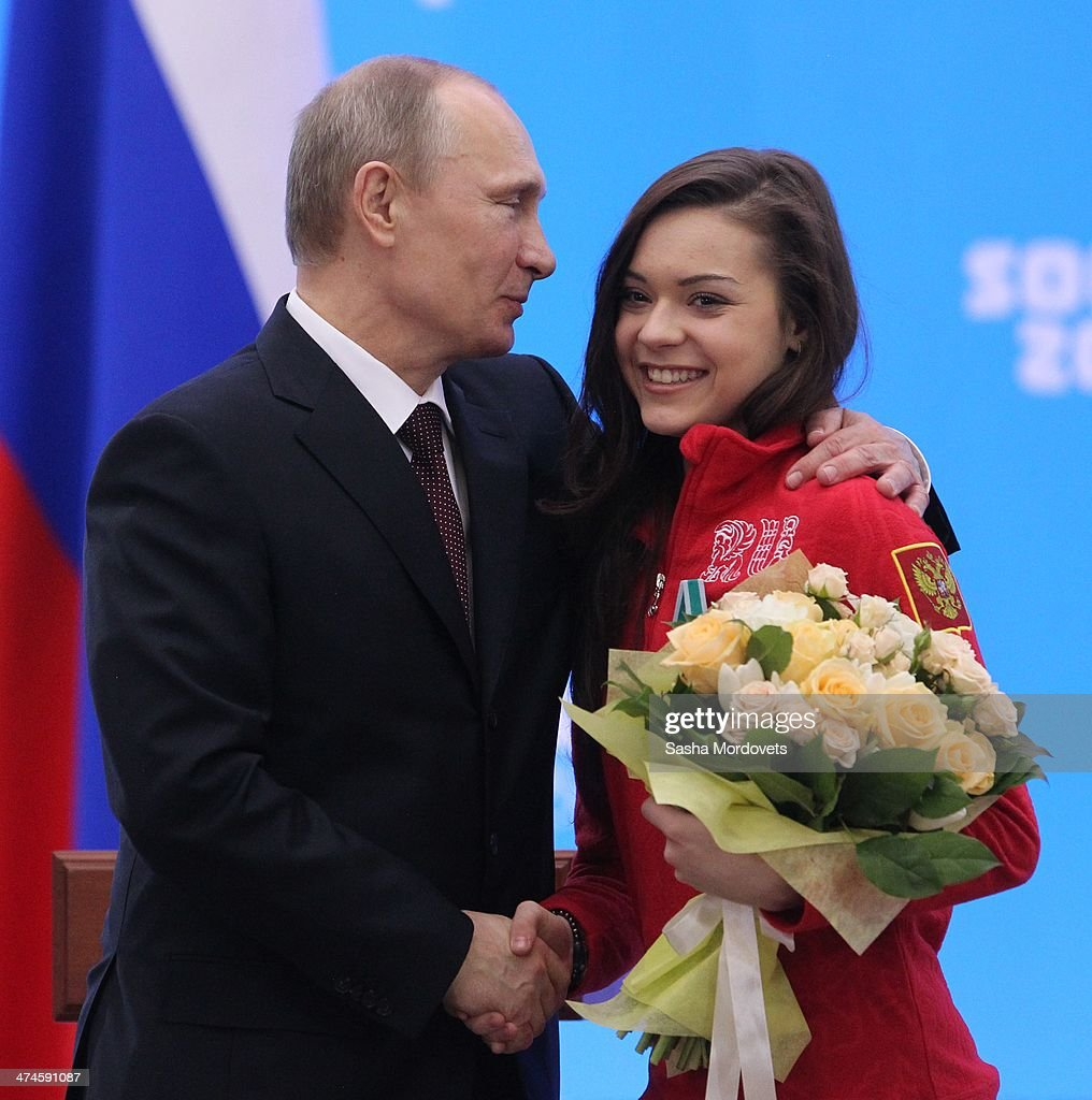 Russian President Vladimir Putin shakes hand with Olympic gold medalist in figure skating Adelina Sotnikova (R) during an awards ceremony for Russian Olympic athletes on February 24, 2014 in Sochi, Russia. Russian President Vladimir Putin presented awards to members of the Russian Olympic team a day after the closing ceremony of the 2014 Winter Olympics, in which Russia topped the medals table with 13 gold, 11 silver and 9 bronze medals.