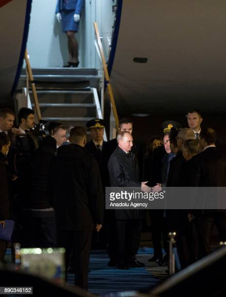 Russian President Vladimir Putin shakes hands upon his arrival at Esenboga International Airport in Ankara Turkey on December 11 2017 Putin is on a...