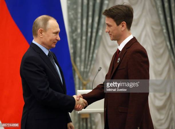 Russian President Vladimir Putin shakes hands with actor Anton Shagin during the awards ceremony at the Kremlim on March 2017 in Moscow Russia has...