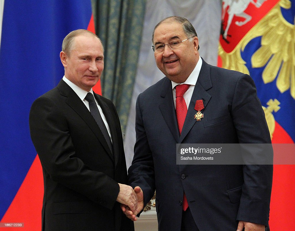 Russian President <a gi-track='captionPersonalityLinkClicked' href=/galleries/search?phrase=Vladimir+Putin&family=editorial&specificpeople=154896 ng-click='$event.stopPropagation()'>Vladimir Putin</a> (L) shakes hands with billionaire <a gi-track='captionPersonalityLinkClicked' href=/galleries/search?phrase=Alisher+Usmanov&family=editorial&specificpeople=5595265 ng-click='$event.stopPropagation()'>Alisher Usmanov</a> during an awards ceremony at the Kremlin October 29, 2013 in Moscow, Russia. Putin awarded 50 Russian artists, actors, scientists, businessmen and workers with orders or medals.