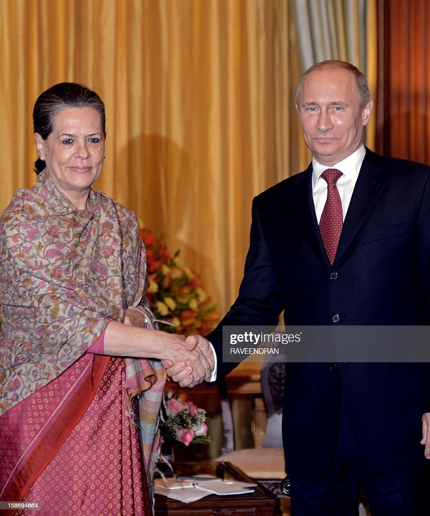 Russian President Vladimir Putin (R) shakes hands with Chairperson of the UPA Government Sonia Gandhi during a meeting at the Presidential Palace in New Delhi on December 24, 2012. Visiting Russian President Vladimir Putin signed deals to sell 71 military helicopters and kits to build 42 fighter jets to India on Monday as he sought to firm up ties with a traditional ally.