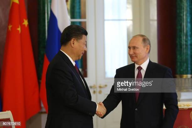 Russian President Vladimir Putin shakes hands with Chinese President Xi Jinping during their meeting at the Grand Kremlin Palace on July 4 2017 in...