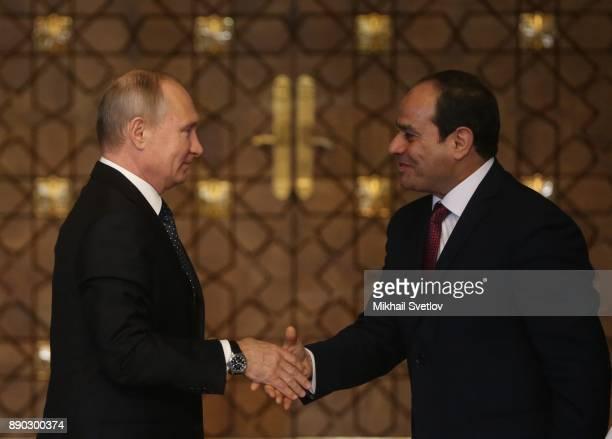 Russian President Vladimir Putin shakes hands with Egyptian President Abdel Fattah elSisi during their meeting on December 11 2017 in Cairo Egypt...