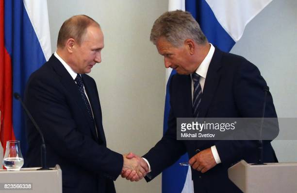 Russian President Vladimir Putin shakes hands with Finland's President Sauli Niinisto during a joint press conference July 27 2017 in Savonlinna...