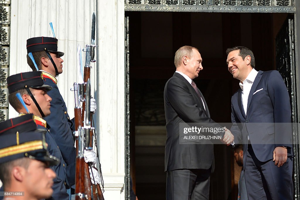 Russian President Vladimir Putin (L) shakes hands with Greek President Prokopios Pavlopoulos during a meeting in Athens on May 27, 2016. Russian President Vladimir Putin was in Greece on May 27 in a visit aimed at reinforcing a relationship with one of his few friends in the EU amid tensions with the West. The visit, Putin's first to the EU since December, comes at a low ebb in relations between Russia and Europe over the conflict in Ukraine that broke out in 2014, with sanctions still in force against Moscow. / AFP / SPUTNIK / Alexei Druzhinin