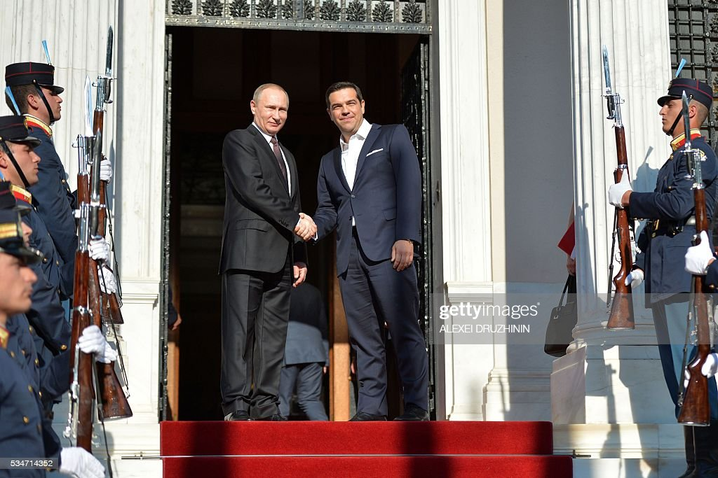 Russian President Vladimir Putin (L) shakes hands with Greek Prime Minister Alexis Tsipras during a meeting in Athens, on May 27, 2016. Russian President Vladimir Putin was in Greece on May 27 in a visit aimed at reinforcing a relationship with one of his few friends in the EU amid tensions with the West. The visit, Putin's first to the EU since December, comes at a low ebb in relations between Russia and Europe over the conflict in Ukraine that broke out in 2014, with sanctions still in force against Moscow. / AFP / SPUTNIK / Alexei Druzhinin