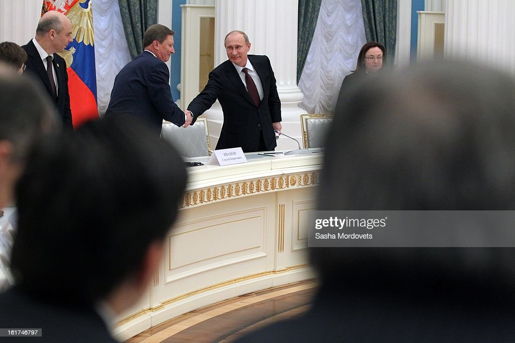 Russian President Vladimir Putin (2nd R) shakes hands with Head of the Presidential Administration Sergey Ivanov (2nd L) during a meeting with G20 finance leaders in the Kremlin February 15, 2013 in Moscow, Russia. The G20 countries, that make up 90 percent of the worlds gross domestic product, is reportedly set to be dominated by the issue of counties using their currency fro economic gain over the weekend of meetings.