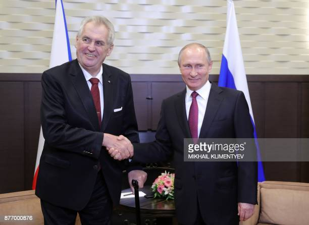 Russian President Vladimir Putin shakes hands with his Czech counterpart Milos Zeman during a meeting in Sochi on November 21 2017 / AFP PHOTO /...