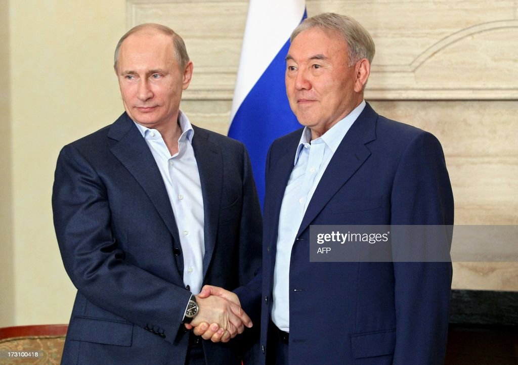 Russian President Vladimir Putin (L) shakes hands with his Kazakh counterpart Nursultan Nazarbayev in Astana on July 7, 2013. The presidents of Kazakhstan and Russia plan to discuss at an ongoing summit in Astana the events in Afghanistan, related to the upcoming withdrawal of troops of the international coalition.