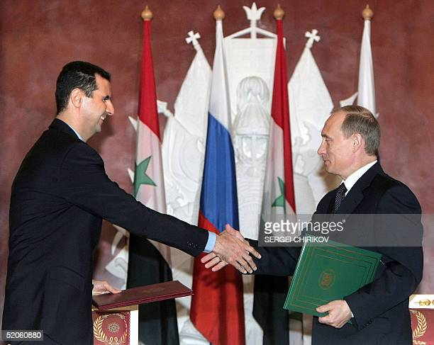 Russian President Vladimir Putin shakes hands with his Syrian counterpart Bashar alAssad during the signing ceremony in the Moscow's Kremlin 25...