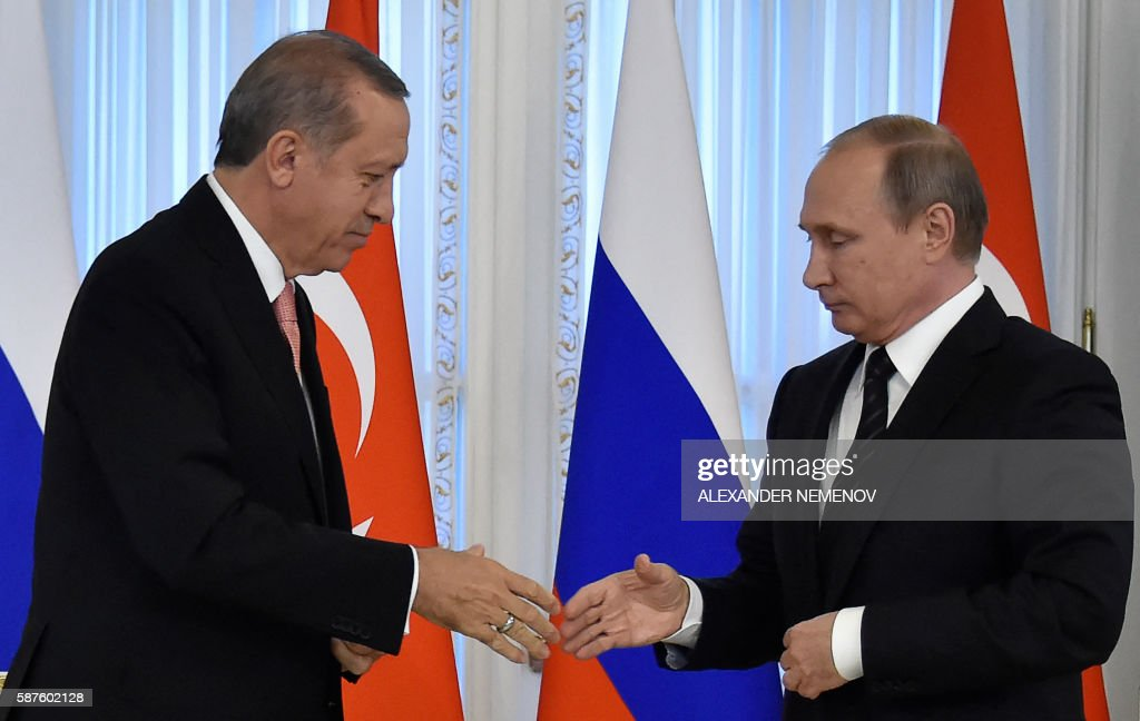Russian President Vladimir Putin shakes hands with his Turkish counterpart Recep Tayyip Erdogan during their press conference in Konstantinovsky...